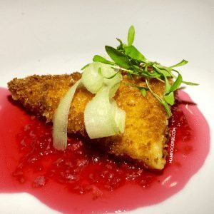 Crispy panko fried gouda with a raspberry couli and shaved celery.