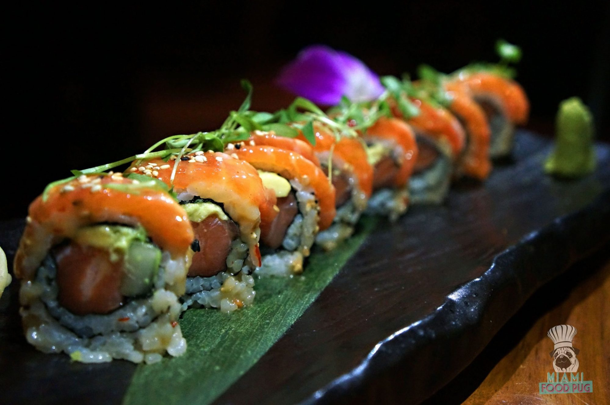 Naiyara's Naiyara Roll - salmon belly, cucumber, avocado, scallion, truffle oil, topped with salmon belly 'crème brulee'